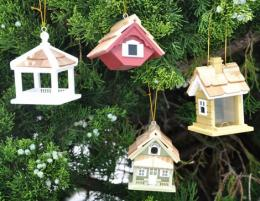 A Mix Of Four Birdhouse Ornaments